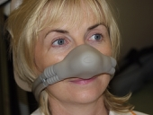 Gordon's nurse Maire wearing an RA mask