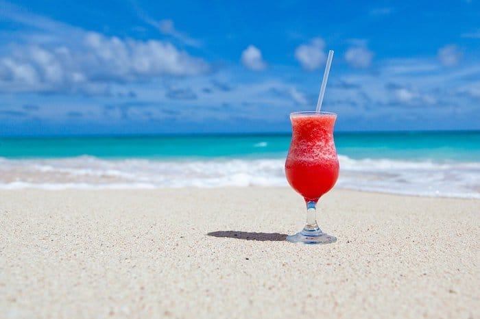 A drink on a beach, illustrating the importance of the sense of taste in the dental environment
