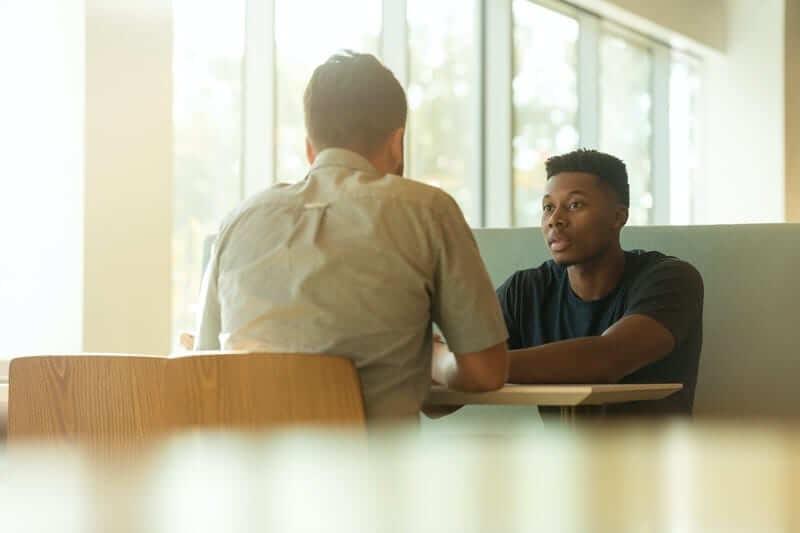 Person confiding in a friend