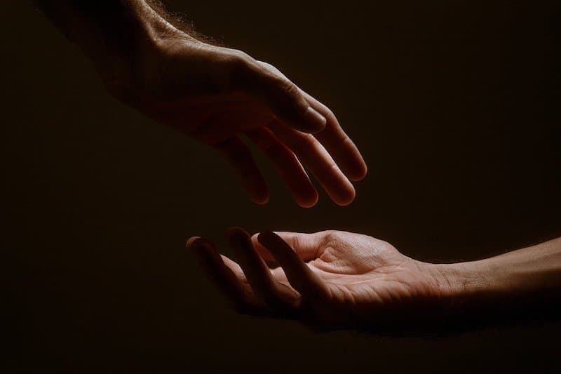 Two hands about to touch, signifying empathy