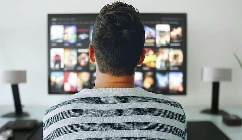 Man distracting himself watching TV