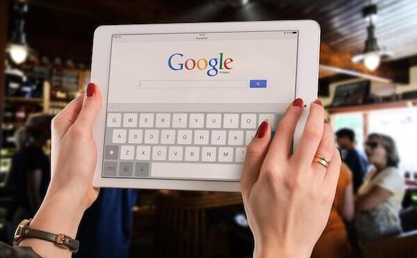 Woman doing a Google search on a tablet